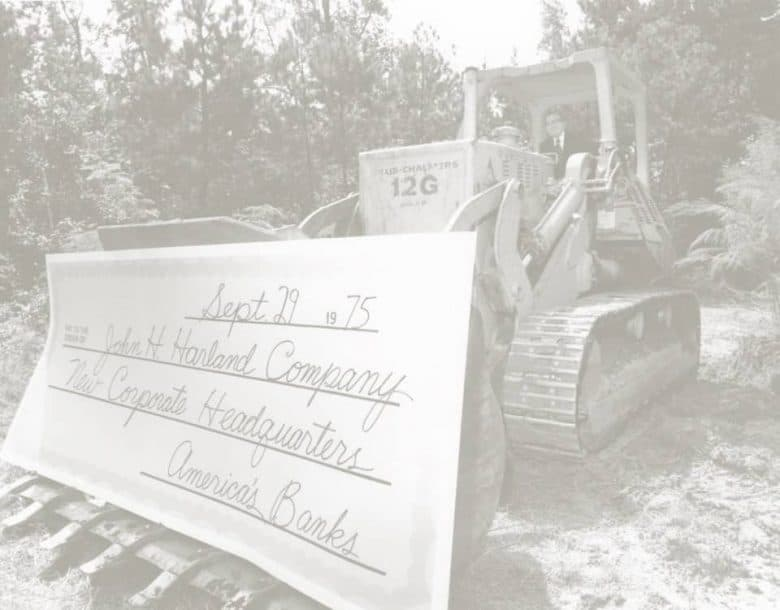 tractor with large check for new headquarters 1970s
